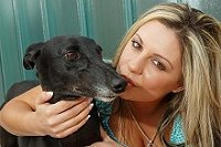 Indi, black greyhound with model Hannah Lewis